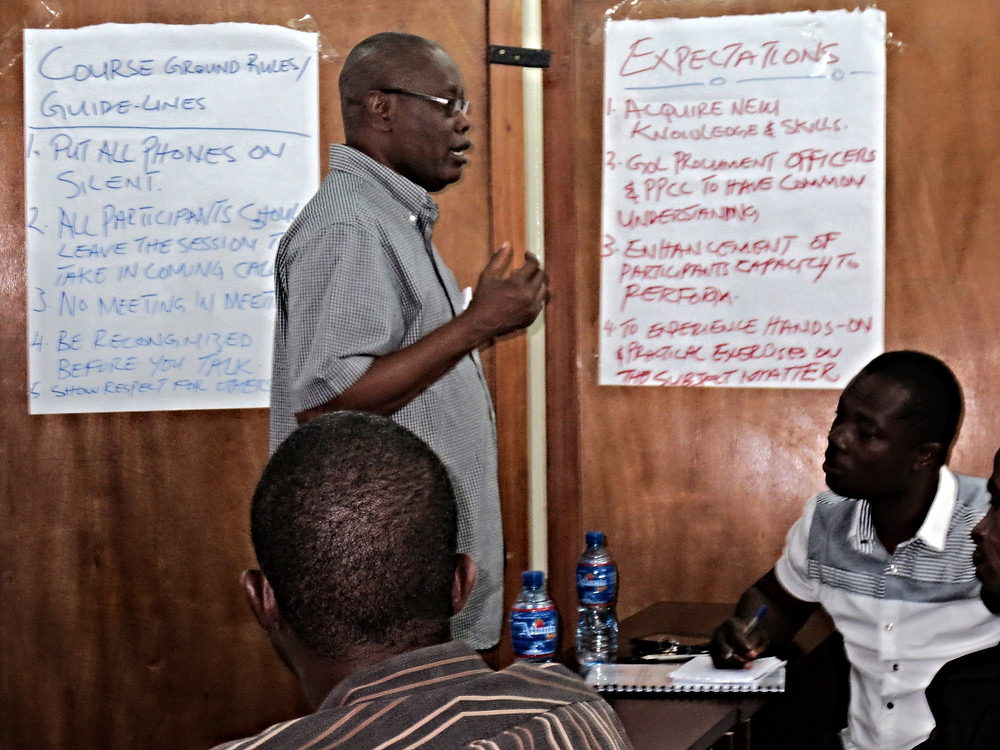 USAID-GEMS Procurement Advisor trains procurement specialists from various ministries in the Government of Liberia