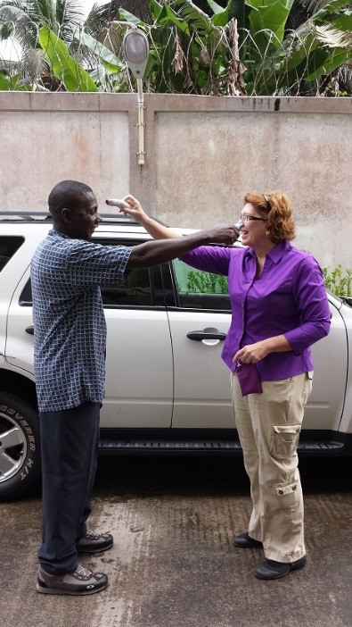 October, 2014: IBI staffers in Monrovia take each other's temperatures before getting in the car.