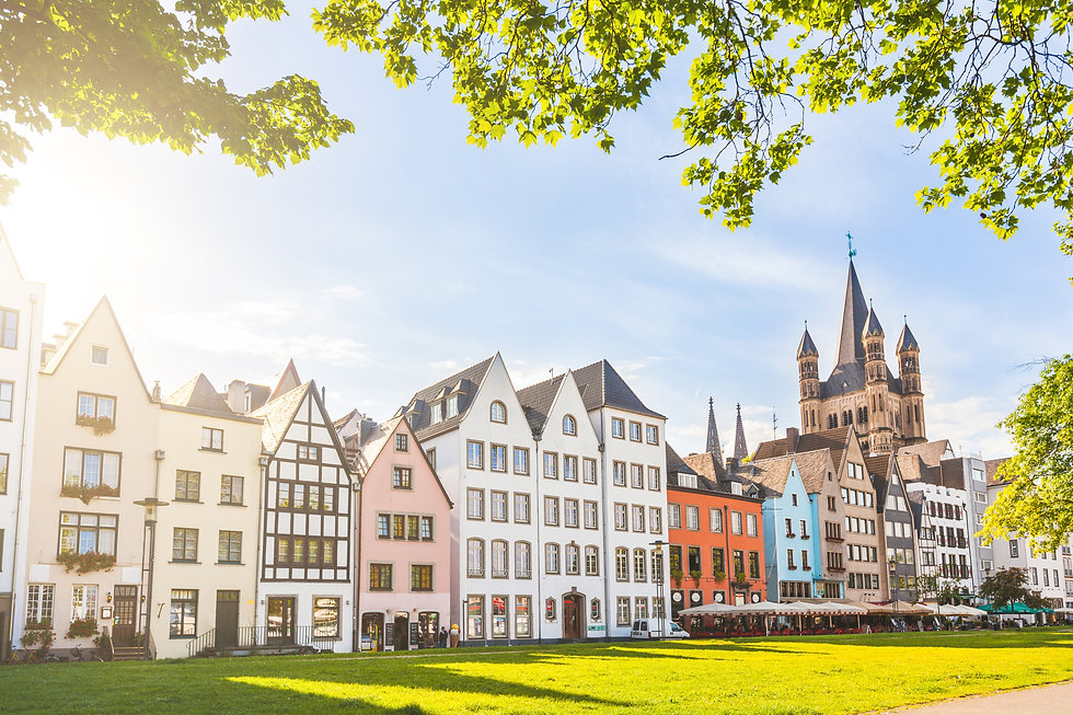 Houses and park in Cologne, Germany. Man