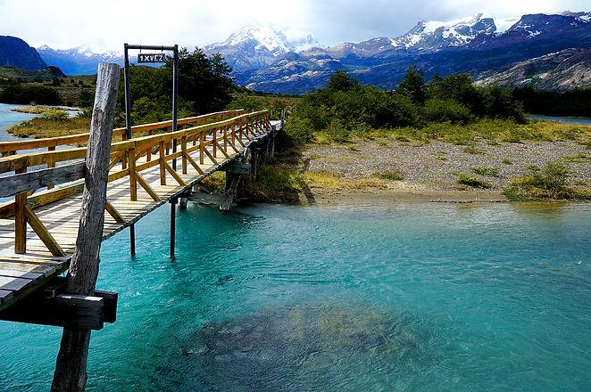 Bridge over glacial river near Estancia Cristina.jpg