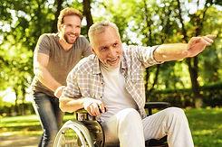 family-walking-park-old-man-sit-wheelcha
