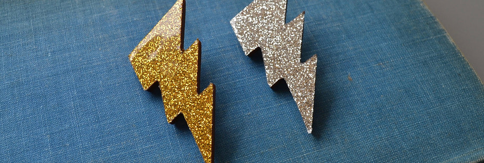 Gold and Silver Lightening Brooches