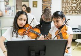 Girls playing violin.jpg