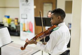 Boy playing violin.jpg