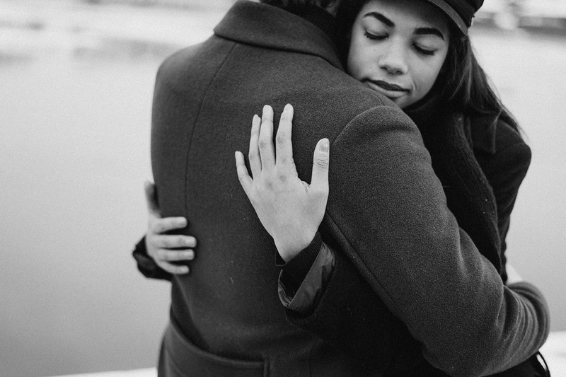 Two people in a loving relationship embracing, sharing deeper intimacy & connection