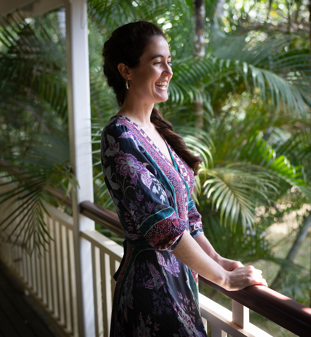 Cairns Holistic Healer Lauren Joy on the veranda of her natural therapy treatment room