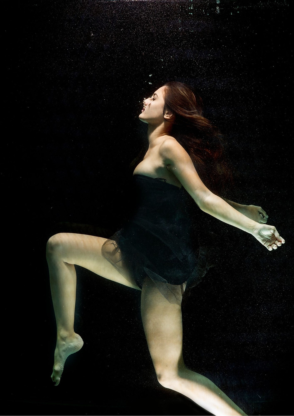 Close-up photo of woman underwater