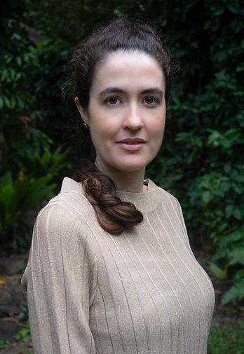 Holistic Healer Lauren Joy Wilson looking thoughtful and reflective in Cairns rainforest
