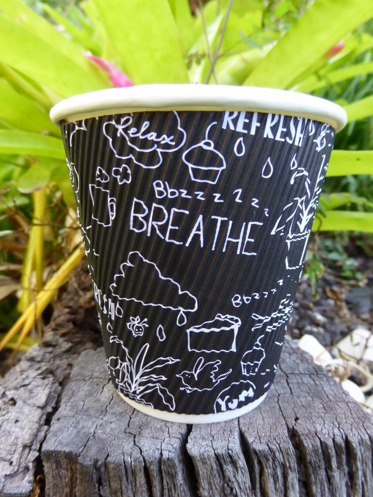 Take-away coffee cup with drawings and affirmations