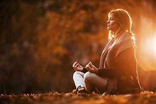 Lady-meditating-outside.jpg