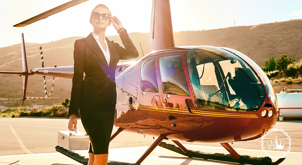 Elegant business woman near the helicopt