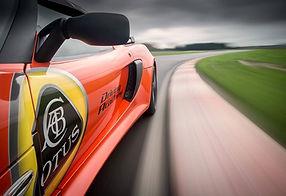 Lotus driving academy oragne car.jpg