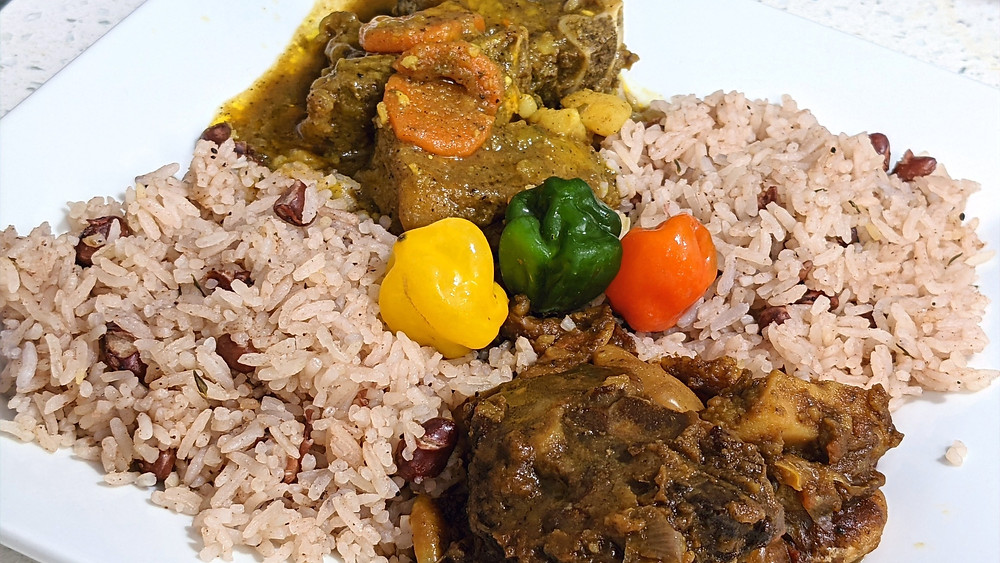 Goat and Oxtail with Rice and Peas