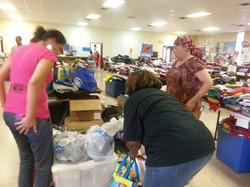 Volunteers sort out items