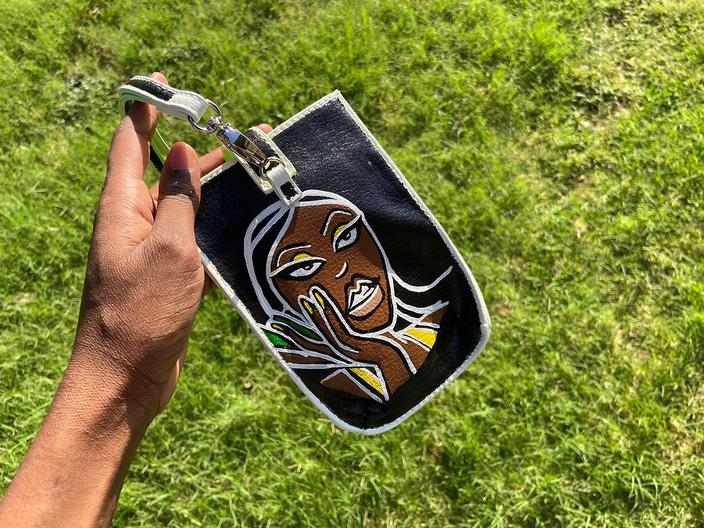 Photo of a painting by Bithia Dantoumda on a purse