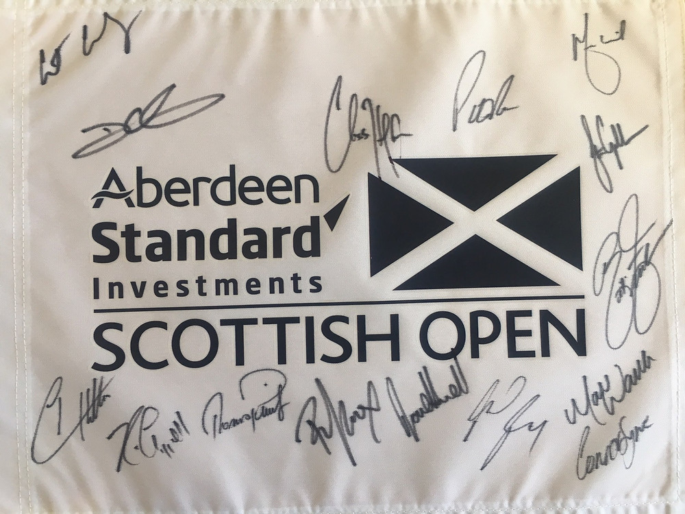 Personally signed by the follow group of world class golfers. Austin Connelly, Charlie Hoffman, Patrick Reed, Darren Clarke, Martin Laird, Marc Warren, Richie Ramsay, Kevin Chappell, Thomas Peiters, Romain Wattel, Connor Syme, Rickie Fowler, Tyrell Hatton and Stephen Gallacher. Another collector's item for the enthusiast.