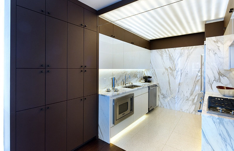 Clean, modern kitchen with marble walls