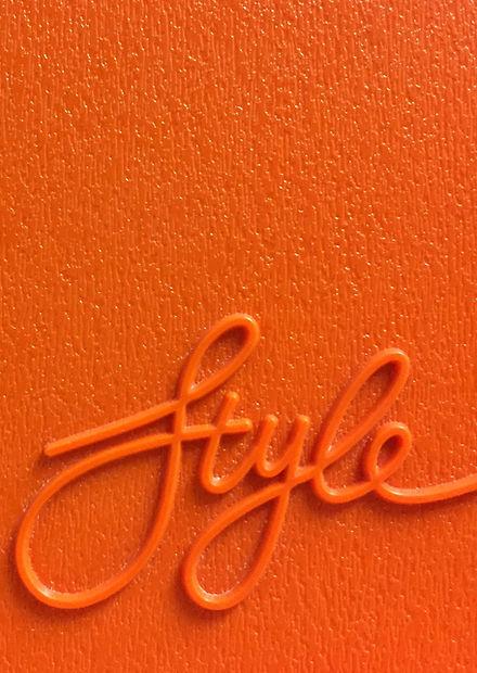 Orange%20Style%20lettering%20on%20a%20vintage%20plastic%20board_edited.jpg