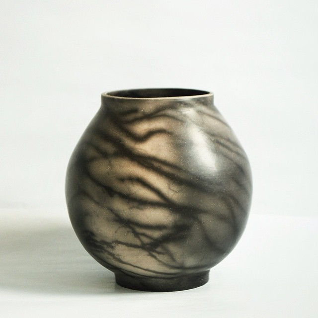 The other side of today's smoke fired pot.  It reminds me a bit of trees silhouetted against the moon.jpg
