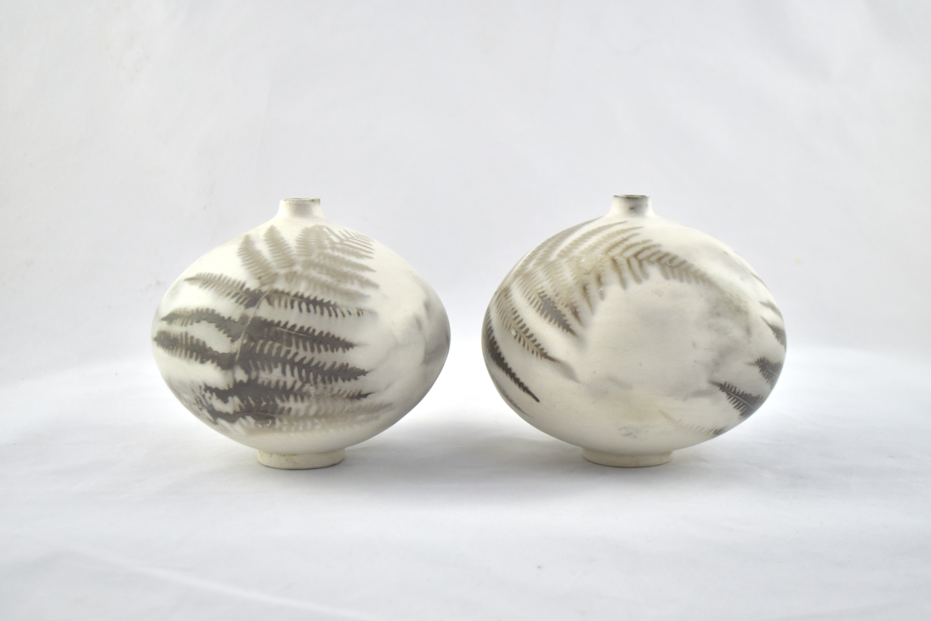 Pair of smokefired fern vessels - 14cm