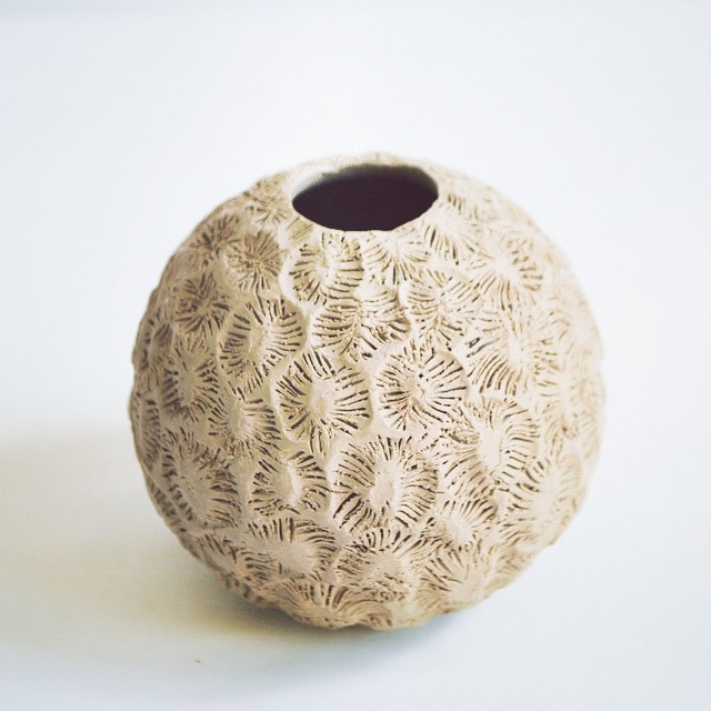 This one is a better version of one of my first pots.  No glaze on it as yet.jpg
