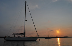 Temptress moored at sunset