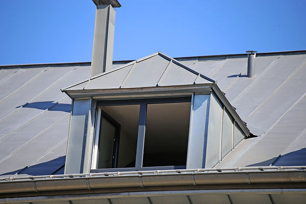 dormer-with-zinc-cladding-on-a-tiled-roo