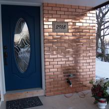 """Copper Tile """"faux brick"""" facade"""