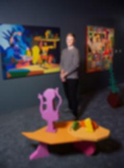 Artist Jonathan Chapline with his work B