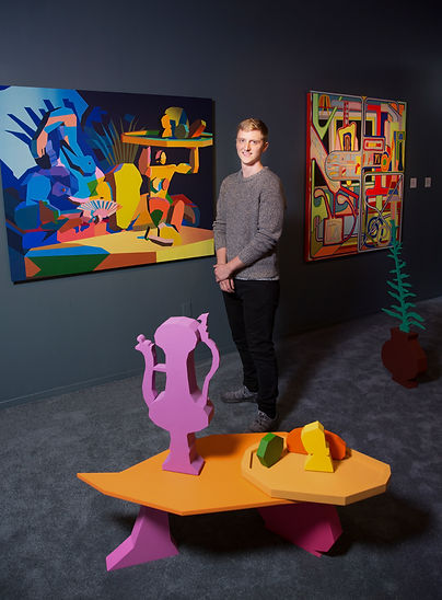 Artist Jonathan Chapline with his work B