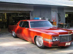 Red-1970-Cadillac-Coupe-Deville