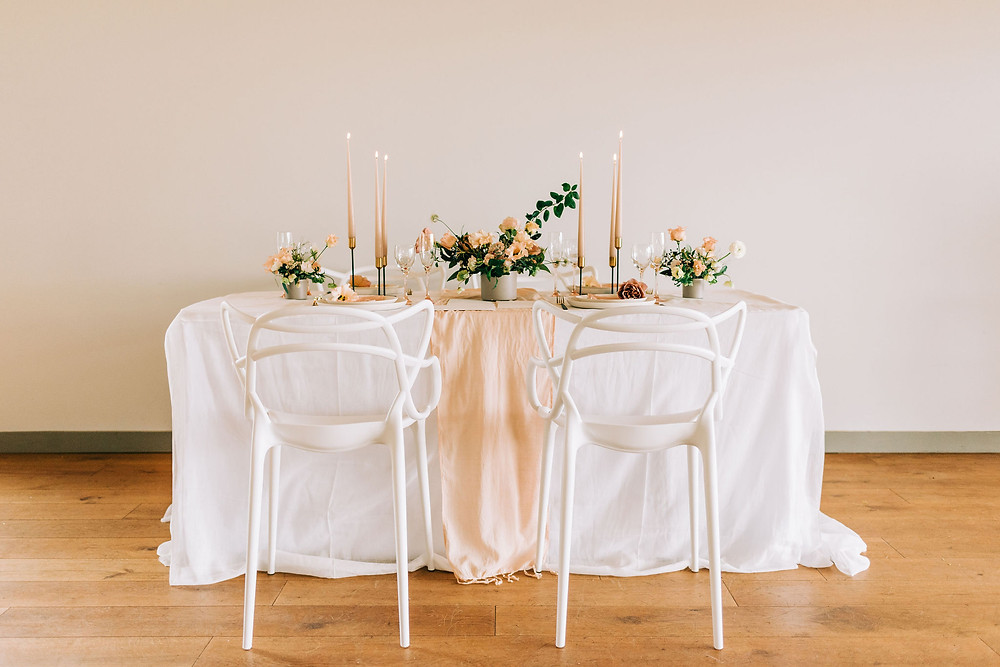 A pretty wedding table setting, ethical wedding design with natural dye linens and beeswax candles