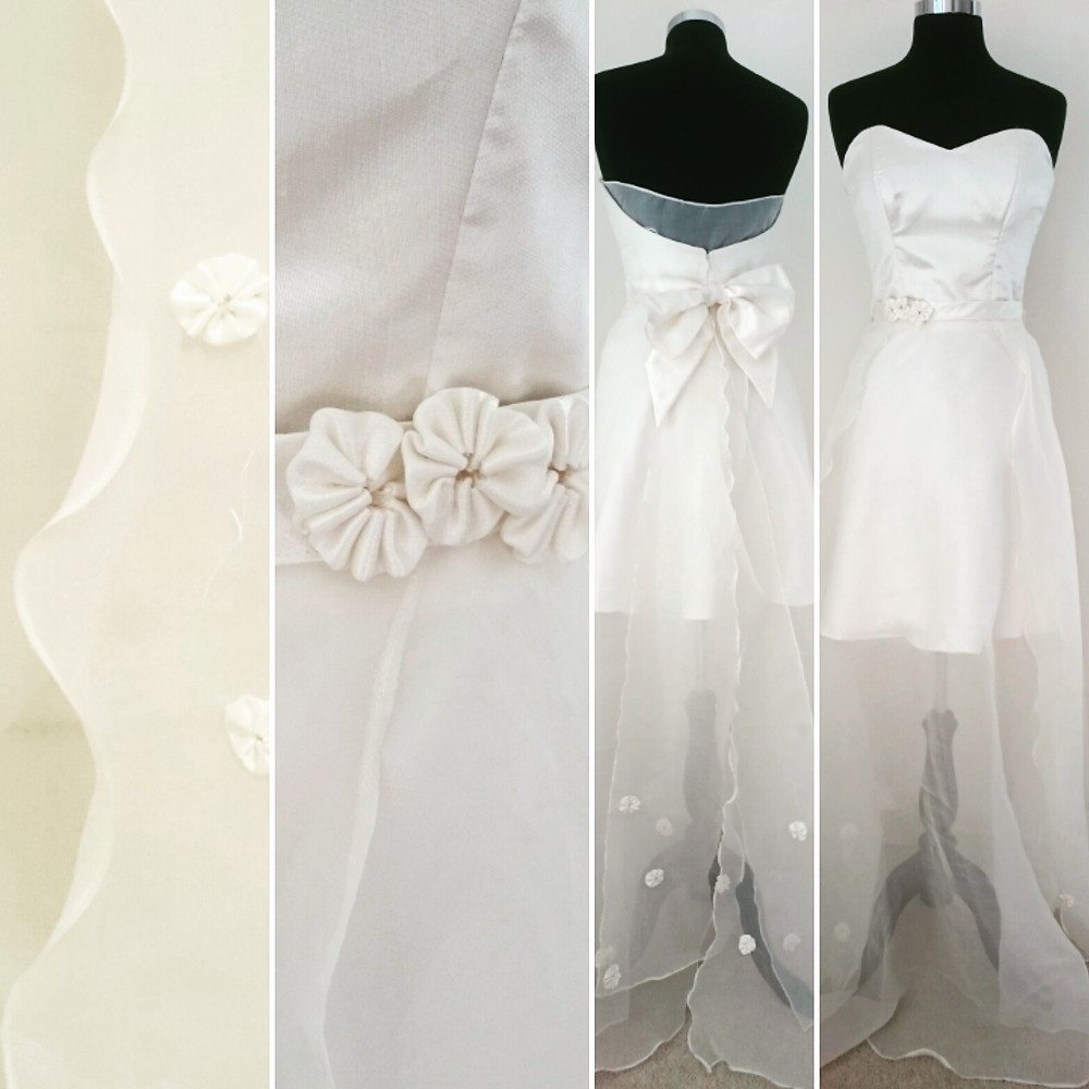 A floral 3D silk organza fabric with a stunning bow behind.  Right on trend for 2016.