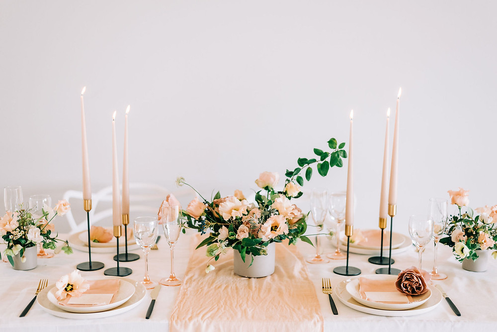 A pretty pink and peach colour for a wedding table setting, made with handmade and eco products for an ethical wedding