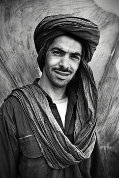 Berber Traits Ahmed left the desert and the flock over 10 years ago to work in a village that grows each year faster because of the increasing rate of tourism, his current livelihoods. ©David Arnoldi