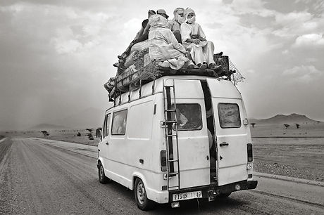 Berber Family Traveling to the Desert Berbers going back home,  after spending a long time working and trading in different towns with textiles and other genres, to meet their family again and share the rewards of work. ©David Arnoldi