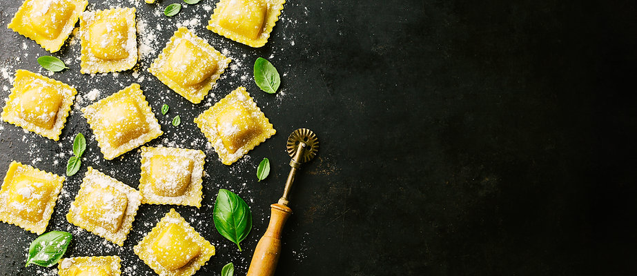 Tasty raw ravioli with flour and basil o