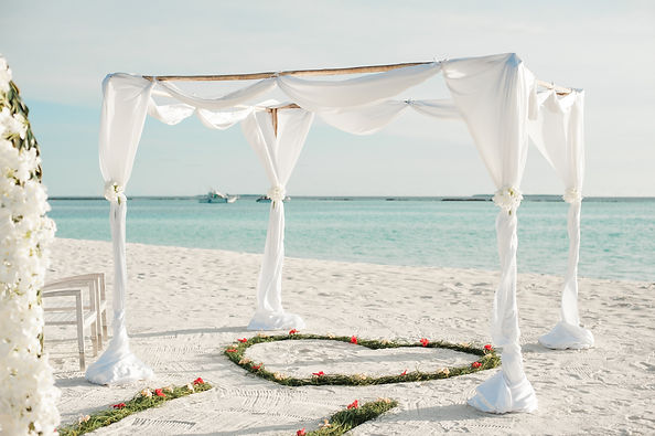 white-fabric-canopy-tent-with-green-hear