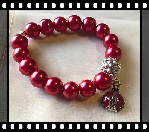Beaded Bracelet with a Ladybug Charm