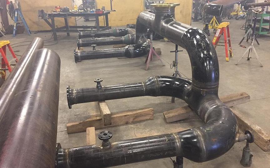 Welded steel pipe header