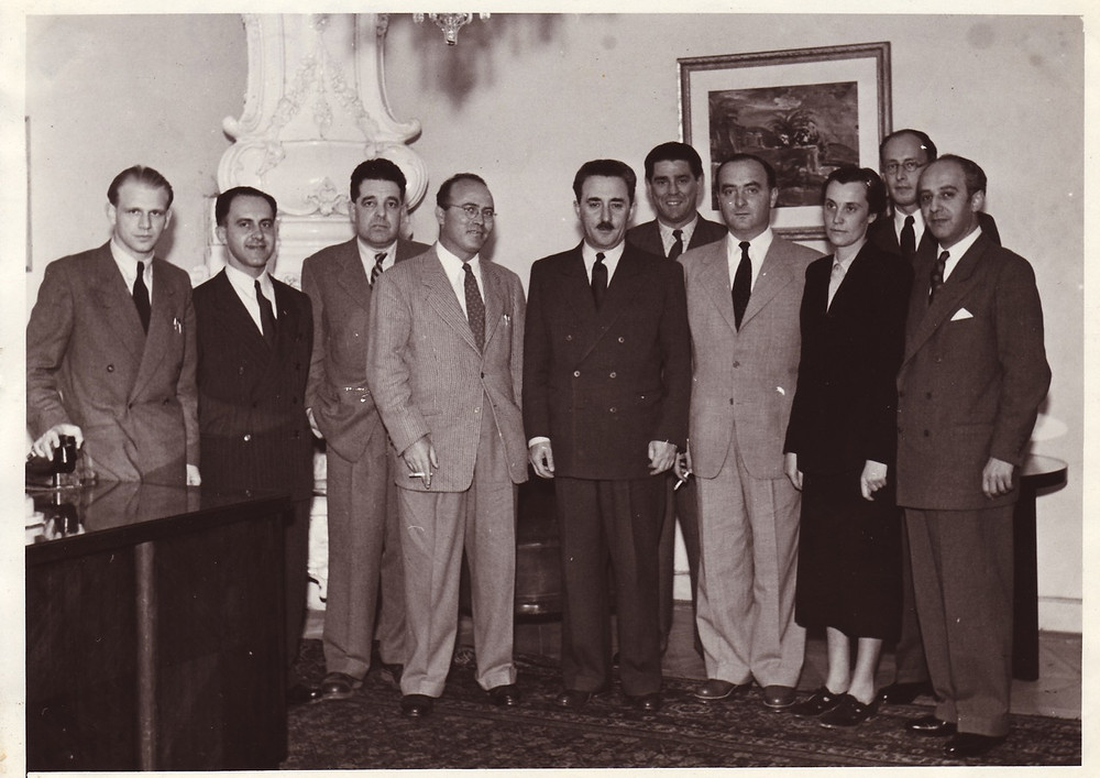 """Photo of Foreign Ministry taken in Prague, between 1949–53 of possible members of the original Mossad as we know it today. On left is Rafi Friedl hero of Slovak Jewish underground in Budapest), The third person from the left was a """"cipher clerk"""" (Yosef Bernstein - Eilom) at the embassy middle is Reuven Shiloah (head of the Mossad), in middle is Moshe Sharett (Shertok) and to his right in back is Zalman and to the far right is Ehud Avriel.  In back right, behind two people is Michael Hutter.    Source: Martin Šmok, Curator, postwar segments of new permanent exhibition for the Spanish synagogue at Jewish Museum in Prague"""