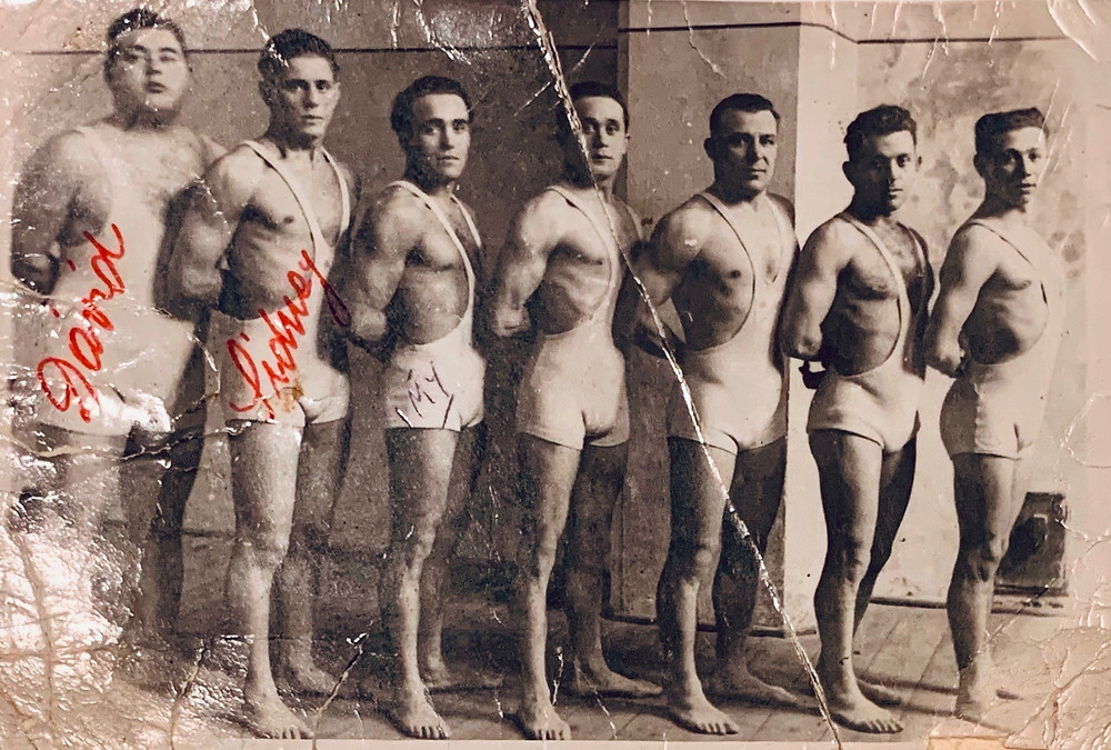 7 wrestlers that includes David Unreich, Zalman and Imrich Lichtenfeld from left to right, in a ŠK Makkabea Bratislava Sports Club.   David Unreich was a world-famous champion wrestler in the 1930s.  Imi Lichtenfeld founded the martial arts called Krav Maga.  Source: Zalman Collection