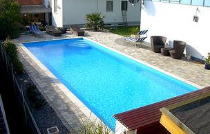 Schwimmbad Folie Betonpflaster Erdarbeiten Palme Erholung im Garten
