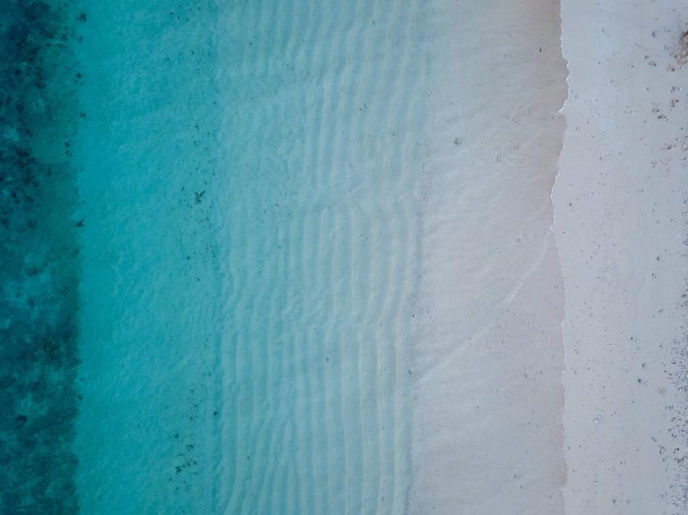 Gradient of water on sandy beach