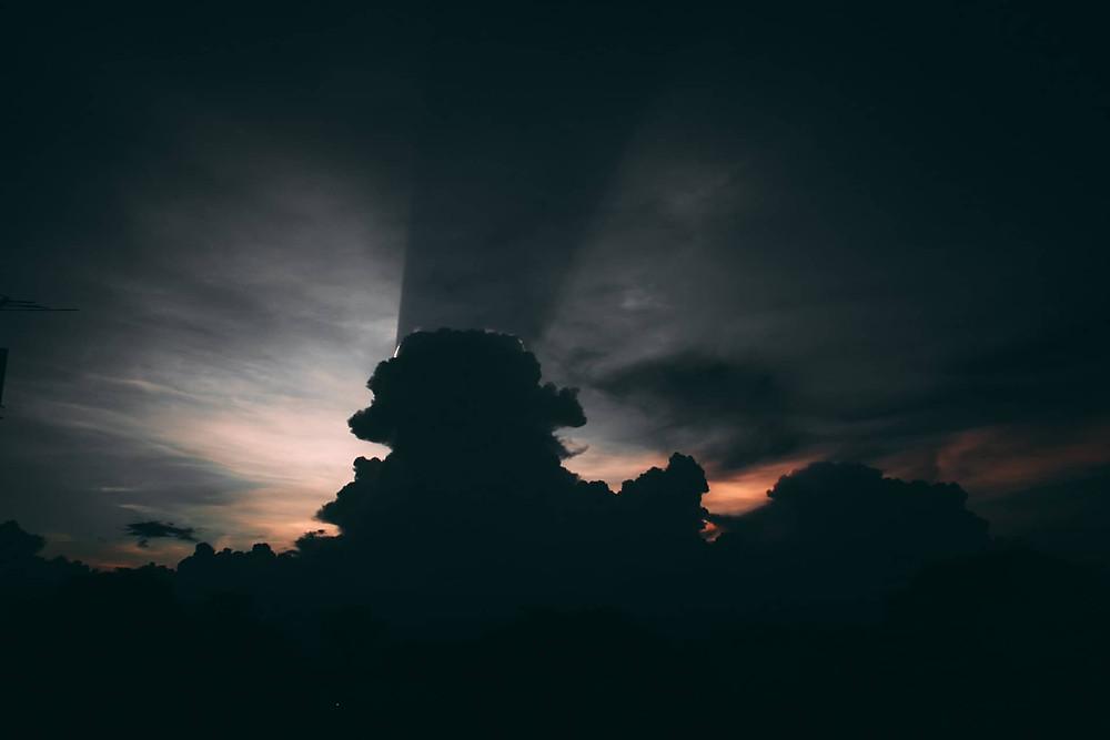 Dark cloud with sun behind