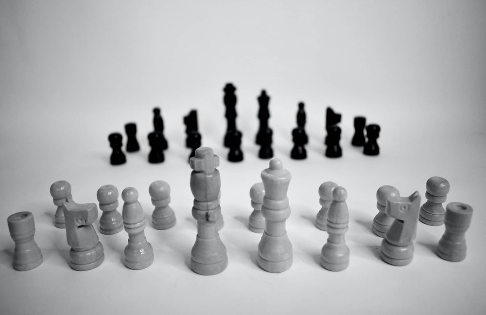 Opposing chess pieces