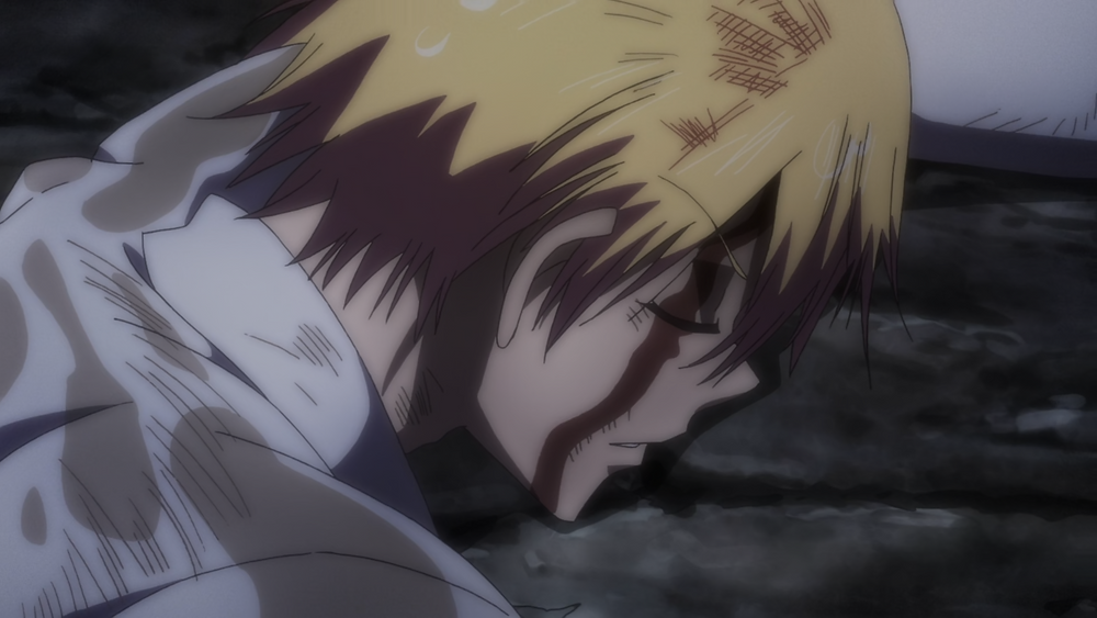 Dr. Ramune, the blond man, is bloody and bruised, lying on a the ground in a forest