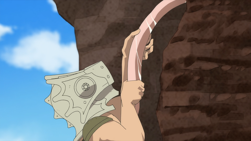 Gugu hanging for dear life after he fell from a balcony, and grabbing on to a pink and slimy tentacle from the rock