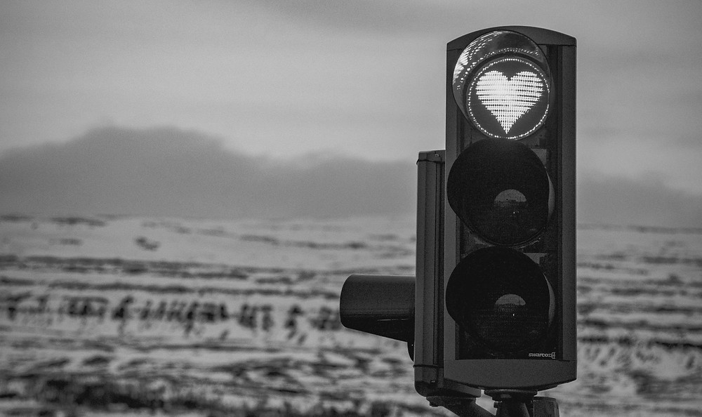 traffic light with a red light in the shape of a heart