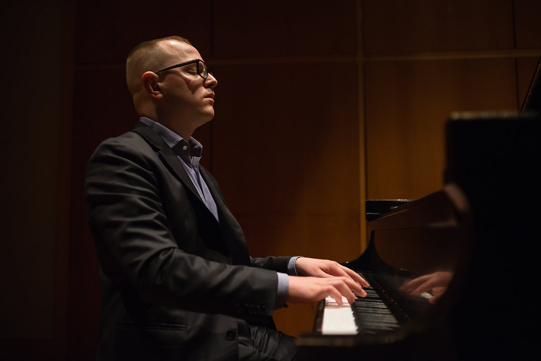 Dan Carunchio playing the piano on stage during one of his concerts